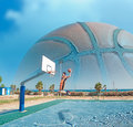 Basketball player dunking by the sea Royalty Free Stock Photo