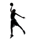 Basketball player dunking silhouette one young man in studio isolated on white background Royalty Free Stock Photo