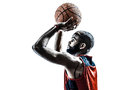 Basketball player free throw silhouette one african man in isolated white background Stock Photos
