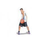 Basketball player holding the ball with one hand Royalty Free Stock Images