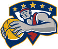 Basketball player holding ball star retro illustration of a facing front set inside shield crest done in style on isolated Stock Photo