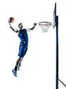 Basketball player jumping dunking silhouette one caucasian man in isolated white background Royalty Free Stock Image