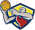 Basketball player laying up ball retro illustration of a rebounding lay set inside shield crest done in style Royalty Free Stock Images