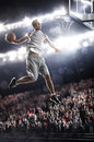 Basketball player in light arena Stock Photo
