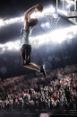 Basketball player in light arena Stock Image