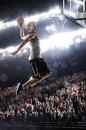Basketball player in light arena Stock Photography