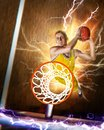Basketball player making slam dunk on basketball arena Royalty Free Stock Photo
