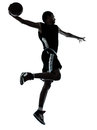 Basketball player one hand slam dunk silhouette young man in studio on white background Royalty Free Stock Images