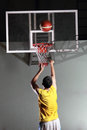 Basketball player prepare to shoot ball in the game Stock Images