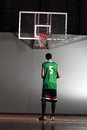 Basketball player prepare to shoot ball in the game Stock Photo