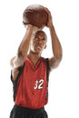 Basketball player shooting ball young african american isolated over white background Royalty Free Stock Images