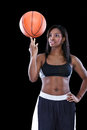 Basketball player spinning ball on his finger female black Stock Photography