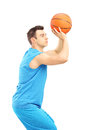 Basketball player about to score a point isolated against white background Stock Photography