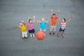 Basketball players image of happy friends playing on sports ground Royalty Free Stock Images