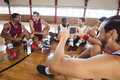 Basketball players interacting while relaxing in the court Royalty Free Stock Photo