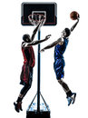 Basketball players man jumping dunking silhouette Royalty Free Stock Photo
