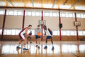 Basketball players ready for the jump ball Royalty Free Stock Photo