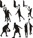 Basketball players silhouette indoor tem sport in action shoot a ball Stock Images