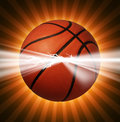 Basketball power as energy light bursting out of the ball as a sports symbol of extreme team game play for championships or Royalty Free Stock Photography