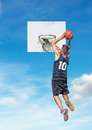 Basketball and sky player dunking with a in the background Royalty Free Stock Images