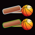 Basketball on tilted bronze checkered banners Royalty Free Stock Photo