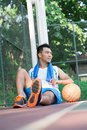 After basketball training vertical image of a tired player having rest outside Stock Image