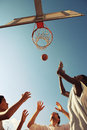Basketball two afro american boy and a men playing against blue sky Stock Image
