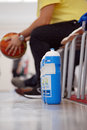 Basketball water suplies with coach in background pictured a ball hands during the game between romania and estonia counting Royalty Free Stock Photography