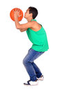 Basketball young boy playing isolated in white Royalty Free Stock Photo