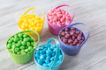 Baskets of brightly colored easter jelly beans with in them Stock Photo