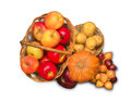 Baskets filled with ripe apples, onions, potatoes and pumpkin Royalty Free Stock Photo