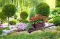 Baskets of flowers on a small cart on a sunny day in the spring Royalty Free Stock Photo