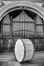 Bass drum large sitting on stage in front of pipe organ Royalty Free Stock Images