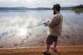 Bass fishing cloud reflections dam landscape fisherman with glass mirror waters and over Stock Photo