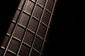Bass fret board detail of the of a guitar on a dark background Royalty Free Stock Photo