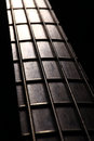Bass fret board detail of the of a guitar on a dark background Stock Photo