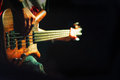 Bassist pop rock during a performance at a concert Royalty Free Stock Photo