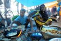 Bastar haat tribal in the a son help his mother to sell pakodaa pizza Stock Images