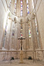 Batalha monastery crucifix stained glass windows and in the apse of the church gothic and manueline masterpiece portugal unesco Royalty Free Stock Images
