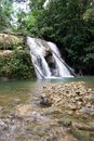 Batanta waterfall in Raja Ampat,  vertical Royalty Free Stock Photo