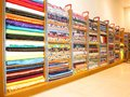 Batch of fabric in a store fabrics by multiple colors for sale by linear meter Royalty Free Stock Image