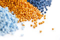 Batch of plastic polymer granules blue and yellow Stock Photos