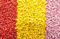 Batch of plastic polymer granules yellow and pink Stock Photo