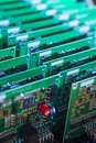 Batch of Ready Printed Circuit Boards with Surface Mounted Components Royalty Free Stock Photo