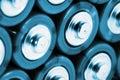 Baterias do AA no azul frio Imagem de Stock Royalty Free