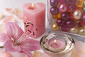 Bath accessories items for various color oil pearls candles rose petals and pink lily Stock Photos