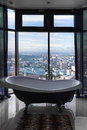 Bath against big window with aerial city view Stock Image