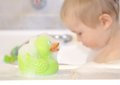 Bath duck and bathing boy green in the background Royalty Free Stock Photography
