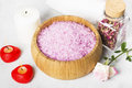 Bath salt with aroma of a rose in a wooden bowl, petals and a fr Royalty Free Stock Photo