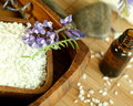 Bath salt and bottle of essence oil, stones and fl Royalty Free Stock Photo